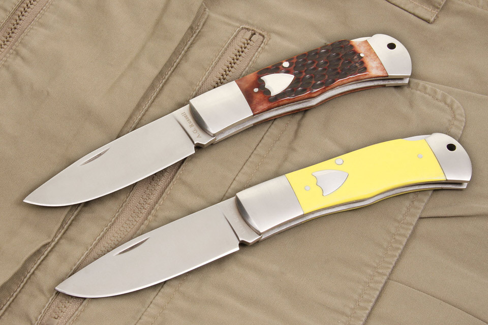 A.G. Russell Folding Hunter Drop point pocket knife in yellow delrin or jigged bone