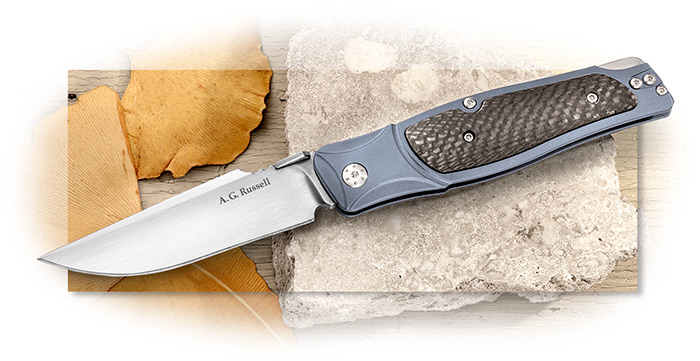 A.G. Russell Blue Lagoon Lockback - anodized blue titanium frame handle with carbon fiber inlay.